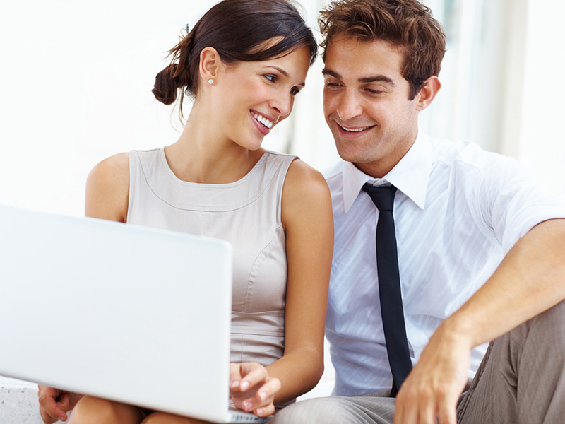 Young business couple working on laptop